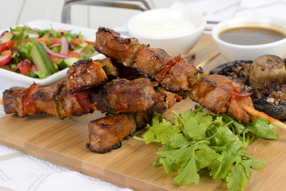 Grilled pork kebabs with bbq & sour cream