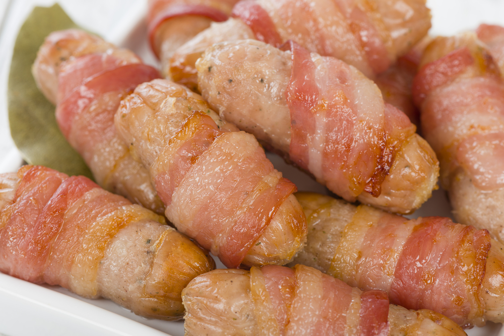 Sausages wrapped in bacon - Christmas Food