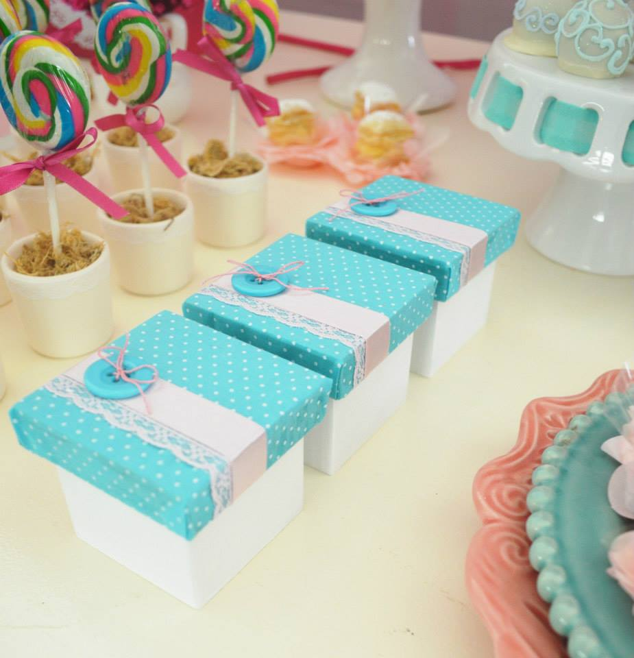 Perfect Enchanted Garden baby shower ideas via baby shower ideas and shops flowers aqua boxes with matching button decor