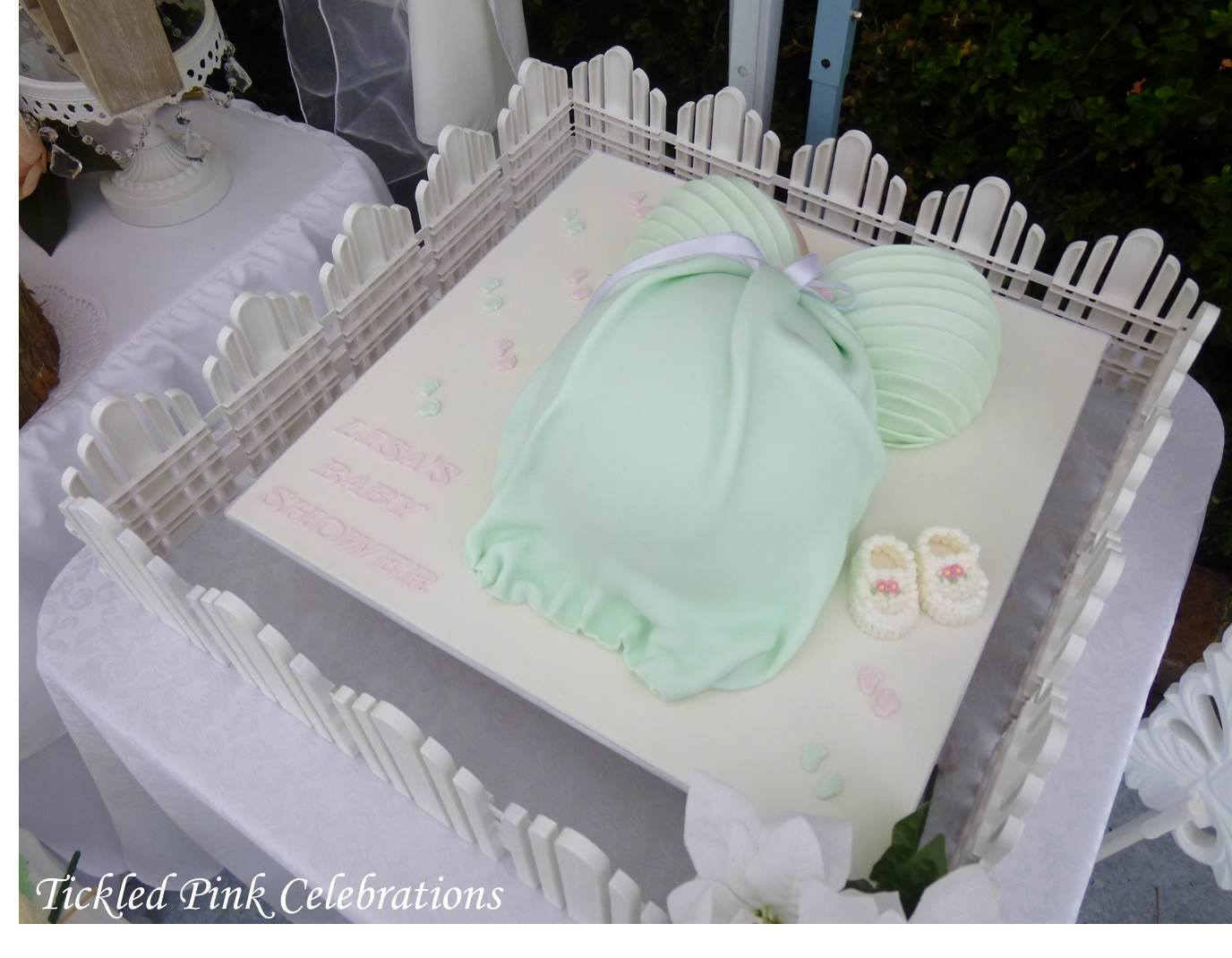 55222b4212d87 Enchanted Garden Baby Shower cake, baby shoe cake, mommy's belly cake