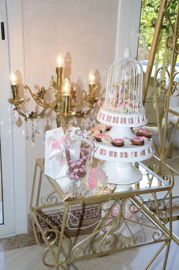 whimsical-spring-swing-celebration-cage-stands